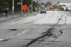 Massive cracks are along the main road into Sumner after the 6.3 magnitude earthquake. Photo / Greg Bowker