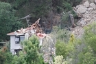 A house destroyed when the cliff at Red Cliffs that collapsed as a result of Tuesday's earthquake, on Main Road, Red Cliffs, Christchurch. Photo /Mark Mitchell