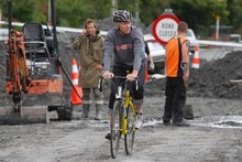 Phil Taylor takes a bike ride along the damaged roads. Photo / Mark Mitchell