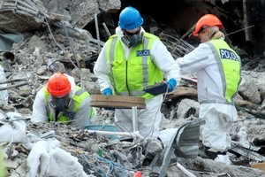 Police forensic teams study the Canterbury Television building that collapsed during the earthquake. Photo / Doug Sherring