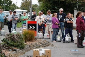 People lined up at a Halswell petrol station for free LPG refills through Contact Energy. Photo / Brett Phibbs