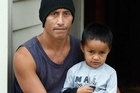 Earthquake survivor and hero Ahsei 'Ace' Sapoaga, with his son 3-year-old Constantine. Photo / Brett Phibbs