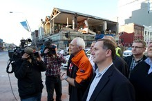 Prime minister John Key, with Christchurch mayor Bob Parker (C) survey damage after the earthquake. Photo / Simon Baker
