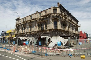 Today's quake is expected cause significant short-term disruption to economic activity, with people unable to go to work and get into shops. This file photo shows damage from last year's quake. File photo / Simon Baker