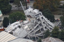 The collapsed Pyne Gould Guiness Building in central Christchurch. Photo / Mark Mitchell