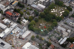 An aerial view of emergency services working at the ruined CTV building (bottom left) and two emergency services base camps set up in Latimer Square (right), in central Christchurch. Photo / Sarah Ivey
