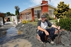 After watching the destruction of the Christchurch Cathedral, Michael Willetts went to the suburb of Avondale to clear liquefaction sludge around his mother's home. Photo / Brett Phibbs