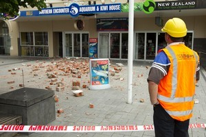 A building inspector surveys damage to a building in Cathedral Square in central Christchurch after one of last year's aftershocks. File photo / Simon Baker