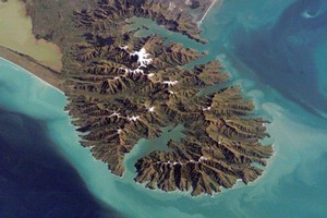 Banks Peninsula from space. Disaster response is just one of many uses for satellite images. Photo / NASA