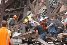 Rescue workers search for survivors through debris in Christchurch. Photo / Getty Images