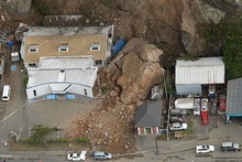 A large land slide lands on a house in Sumner. Photo / Getty Images