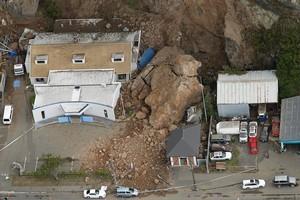 A large landslide lands on a house in Sumner. Photo / Getty Images