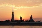 Midnight sun behind the Peter and Paul Fortess on the Neva River, St Petersburg. Photo / Jim Eagles