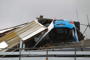 A smashed car is seen in a car parking building in Christchurch today. Photo / Getty Images