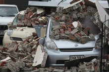 Cars covered in rubble after the earthquake in Christchurch. Photo / Greg Bowker