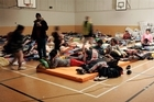 People take refuge in the Burnside High School gymnasium. Photo / Sarah Ivey