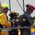 Rescue workers are lifted on to the top of the Pyne Gould Guiness builing. Photo / Getty Images