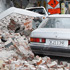 Cars covered in building debris on February 22, 2011. Photo / Getty Images