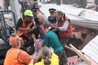 Emergency services and volunteers rescue people from the collapsed CTV building. Photo / Geoff Sloan