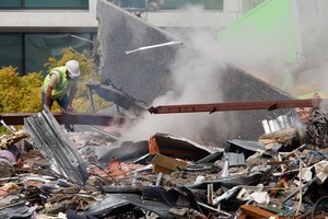 Emergency workers search the wreckage of a building after the Christchurch earthquake. Photo / Brett Phibbs