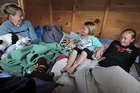 The Bruin family of Redcliffs have moved out of their earthquake-damaged home and into their children's cramped but cosy playhouse.