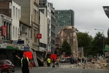 One of the main streets in Christchurch is seen littered with rubble. Photo / @PolarBearFarm via Twitter