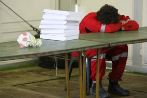 A Red Cross worker sleeps at the Civil Defence Emergency Centre. Photo / Greg Bowker