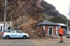 Large rocks have slid off a cliff face in Sumner onto cars following the 6.3 earthquake in Christchurch.