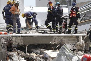 Rescue teams at work on rubble at the site of the CTV Building. Photo / Mark Mitchell