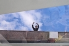 New-found friend Alexei waves to boat passengers from a bridge above the canal in St Petersburg. Photo / Bronwyn Elsmore
