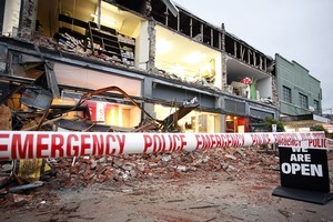 Retail shops in Merivale are left open to the elements following yesterday's massive earthquake in Christchurch. Photo / Getty Images