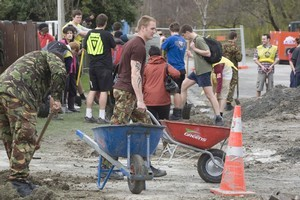 Volunteers cleaning up in Kaipoi after September's earthquake. Photo / Mark Mitchell