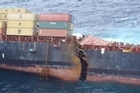 The stricken cargo ship Rena has split in two but remains firmly wedged on the Astrolabe Reef off the coast Tauranga.
