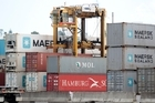 A straddle Carrier lifts shipping containers at the Ports of Auckland. Photo / Richard Robinson