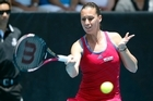 The singles final between Flavia Pennetta (above) and Jie Zheng could be put off until tomorrow. Photo / Dean Purcell.