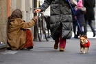 A woman begs in downtown Milan, Italy, the eurozone's third-largest economy. Photo / AP