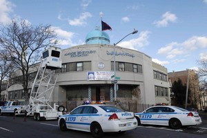 Police test an overhead surveillance lift in front of the Iman al-Khoei Benevolent Foundation in New York. Photo / AP