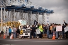Union members stand on the picket line outside the Ports of Auckland. Photo / File