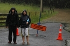 Campers Shaun Dunlop and Iva Novakov endure the bad weather in Whangamata on New Year's Eve. Photo / Christine Cornege