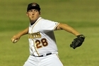 Andrew Marck pitches for Brisbane. Photo / SMP IMAGES/ABL