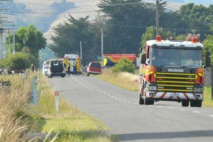 Emergency services attend the scene of the crash. Photo / Wairarapa Times-Age