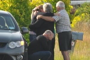 Friends and relatives console one another at the scene of the hot air balloon crash. Photo / Wairarapa Times-Age