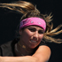 Aravane Rezai of France plays a shot in her match against Shuai Peng of China during day two of the 2012 ASB Classic. Photo / Getty Images
