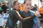 Cara Baker (left) hugs runner-up Charlotte Webby after winning the Auckland Harbour crossing. Photo / Greg Bowker