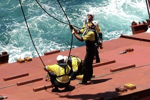 Riggers prepare a hatch cover for removal of a container on the Rena. Photo / Maritime NZ