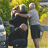 People embrace at the scene of the crash. Photo / Chris Kilford