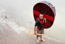 Justin Newcombe prepares to embark at Pt Chevalier beach. Photo / Steven McNicholl