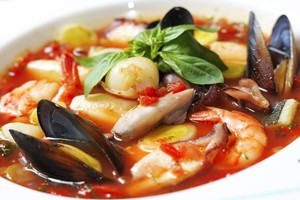 Seafood suits being piled into a generous pot of soup. Photo / Thinkstock