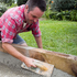 Smoothing down the concrete with a trowel. Photo / Natalie Slade