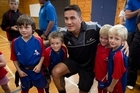 All Black Sonny Bill Williams gets mobbed by young fans during a visit to Manurewa High School with All Black Richard Kahui to spread the word about rugby registration.  6 March 2012  New Zealand Herald Photograph by Natalie Slade